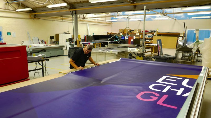 Preparing Giant Banner for European Cycling Championships
