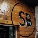 Scott Brothers Hand Painted Logo to Wooden Panelling