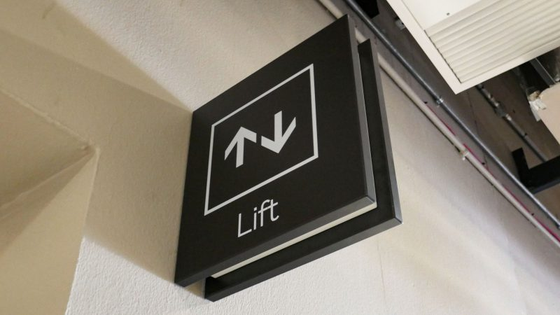 Projecting Lift Sign at Venue