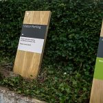 Oak Monolith Parking Signs with Routered Logos and Aluminium Panels