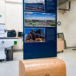 Robertson Construction Clear Acrylic Digitally Printed Display Stand with Oak Base