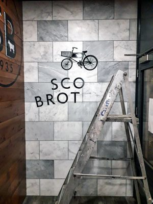 Scott Brothers Sign Writing Work in Progress