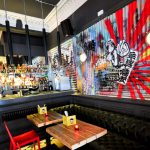 Bar fit out and seating area with large format graphic in Asian