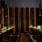 Illuminated walls and bespoke joinery in restaurant